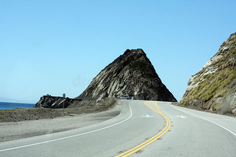 Huge rock on State Route 1 in Malibu, CA stock photography