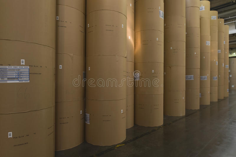 Huge Rolls Of Paper In Newspaper Factory. View of huge rolls of paper in newspaper factory royalty free stock photography