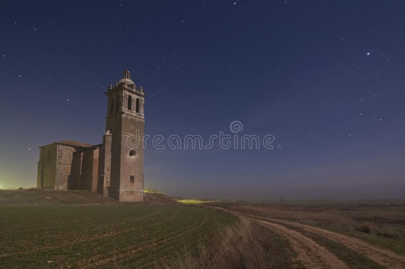 Romanesque Church sanctuary under moonlight  starry night sky royalty free stock image
