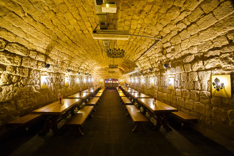 The huge room full of wooden tables decorated with brick walls and download the huge room full of wooden tables decorated with brick walls and vintage lamps aloadofball Image collections