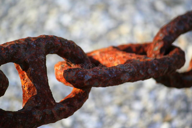Huge rusty linked anchor mariner chain from ocean liner. royalty free stock image
