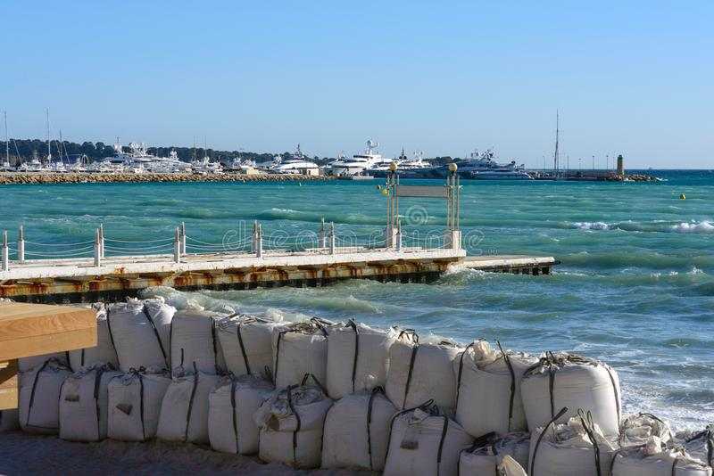 Huge sandbags on the beach of the French city of Cannes. Strengthening the coast. royalty free stock photography