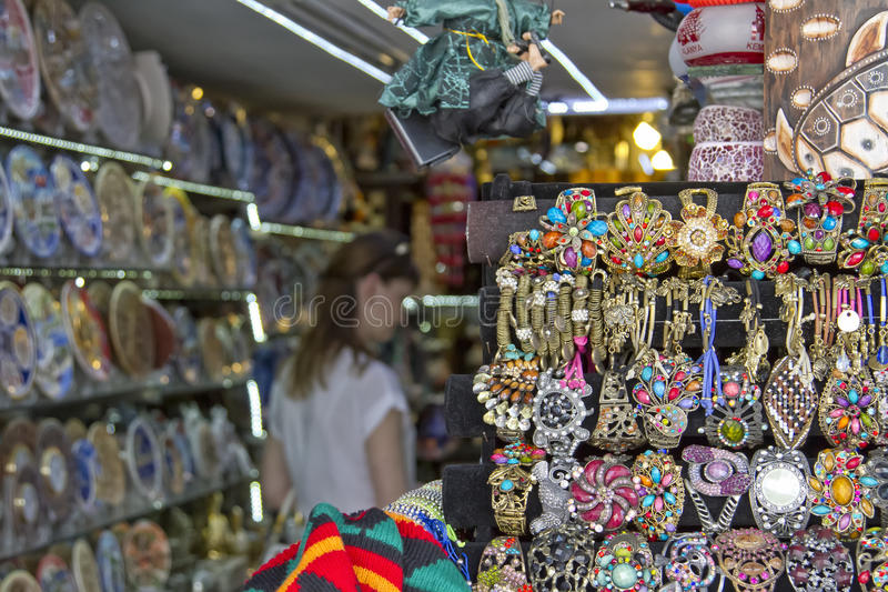 Huge selection of beautiful and affordable Souvenirs for tourists on the shelves of street shops royalty free stock photography