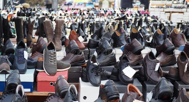 Huge selection of shoes in a big open store royalty free stock image