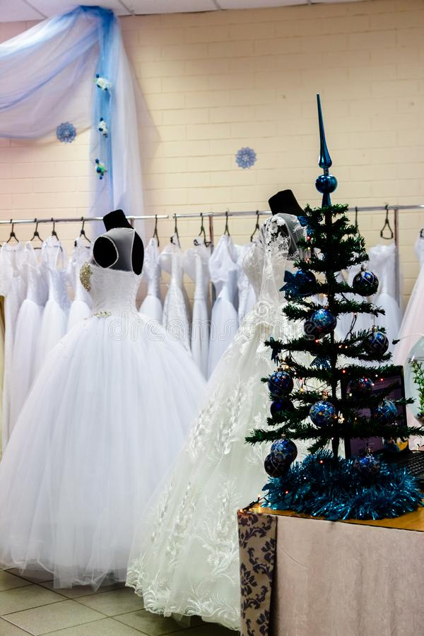 A huge selection of wedding dresses in the wedding salon royalty free stock photography