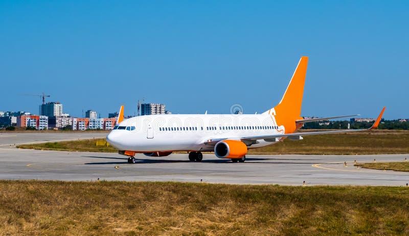 Huge shiny airplane at the runway royalty free stock photos