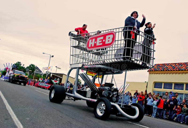 Huge shopping cart in parade stock photography