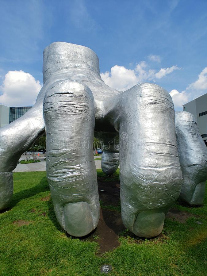 One sliver hand sculpture in University Circle uptown district of Cleveland. Huge Silver hand sculpture in University Circle uptown district of Cleveland, Ohio stock photo