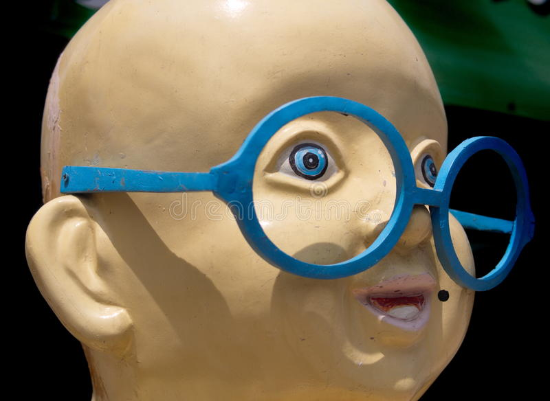 Huge smiling face with large glasses stock photos