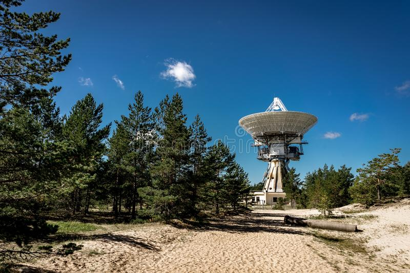 A huge soviet radio telescope near abandoned military town Irbene in Latvia. Former super-secret Soviet Army space. Spying object.Now largest radio telescope in stock photo