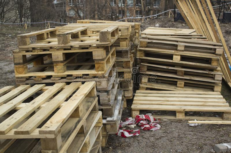 Huge stack of different type of pallet at a recycling business area stock images