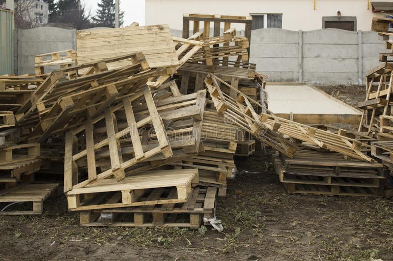 Huge stack of different type of pallet at a recycling business outdoor area royalty free stock photography