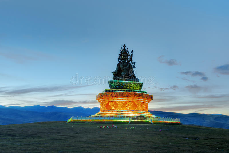 Huge statue of buddha at dusk royalty free stock images
