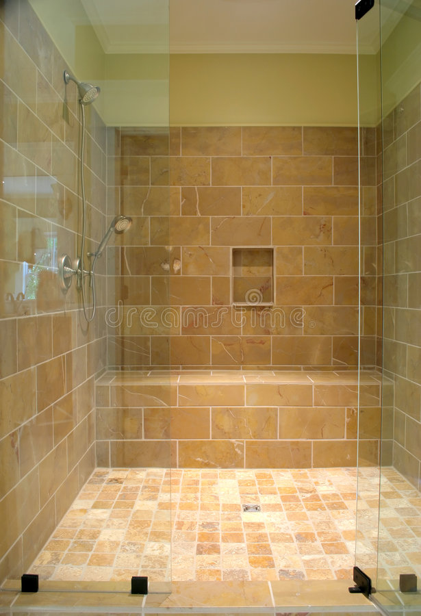 Huge stone and glass shower stock photography