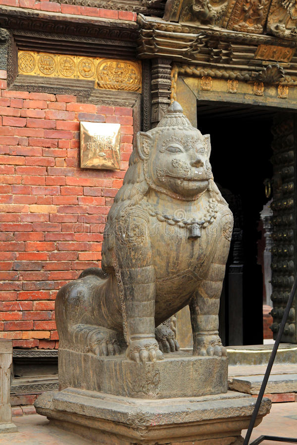 A huge stone lion guarding Patan Museum in Patan, Nepal stock photography
