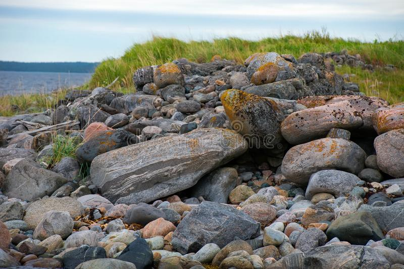 Huge stones on the coastline. Of the Bolshoy Zayatsky Island. Solovetsky archipelago, White sea, Russia royalty free stock photo