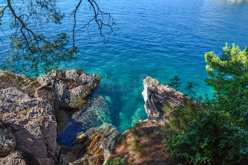 Huge stones in the sea and waves. On a sunny day. View from above. Montenegro. The Budva Riviera.  stock images