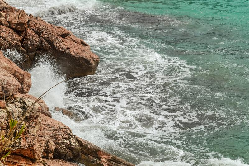 Huge stones in the sea and waves. On a sunny day. View from above. Montenegro. The Budva Riviera.  royalty free stock photography