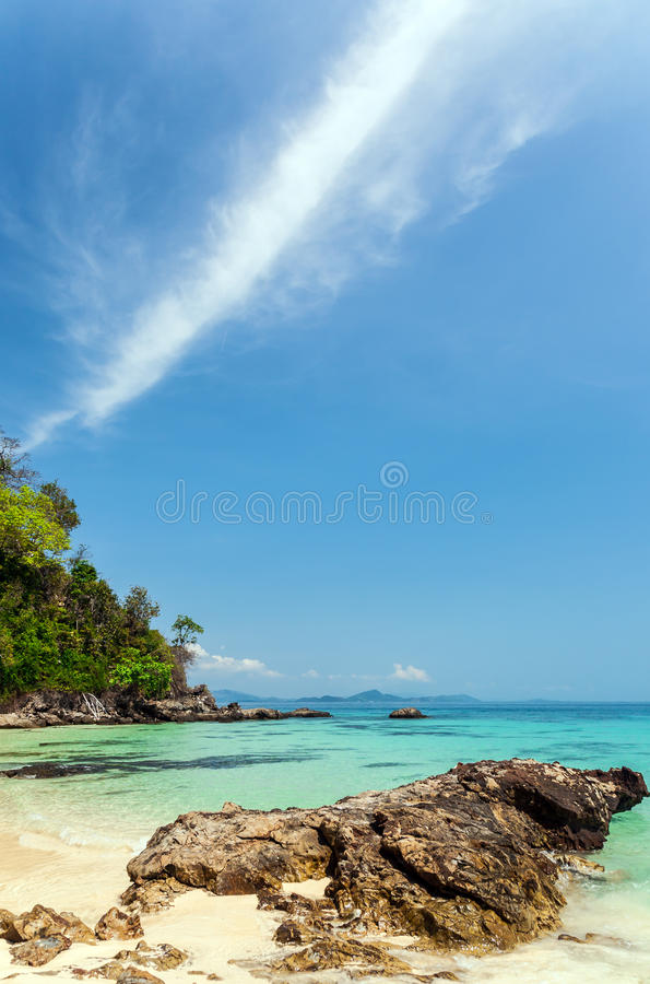 Huge stones on the seashore. Huge stones on the shore of Maiton Island, Thailand, on a sunny day. Clouds in the blue sky royalty free stock photo