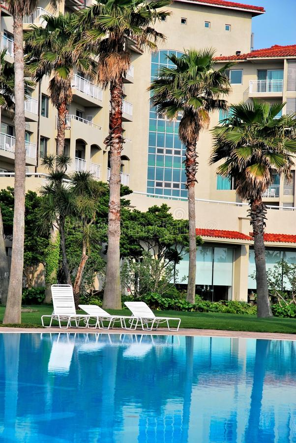 Huge swimming pool with luxurious resorts stock photo