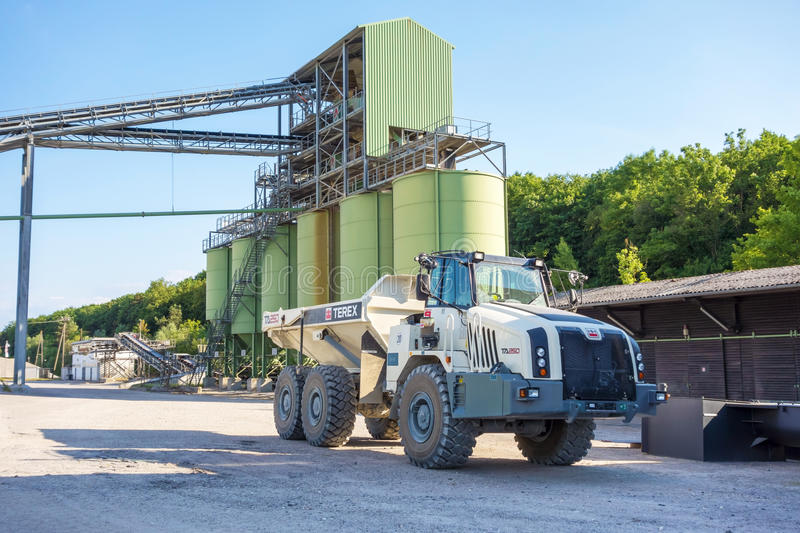 Huge Truck. Hagenbach, Germany - May 31, 2014: Large Volvo Terex Truck TA 250 in open pit mining and processing plant for crushed stone, sand and gravel at stock image