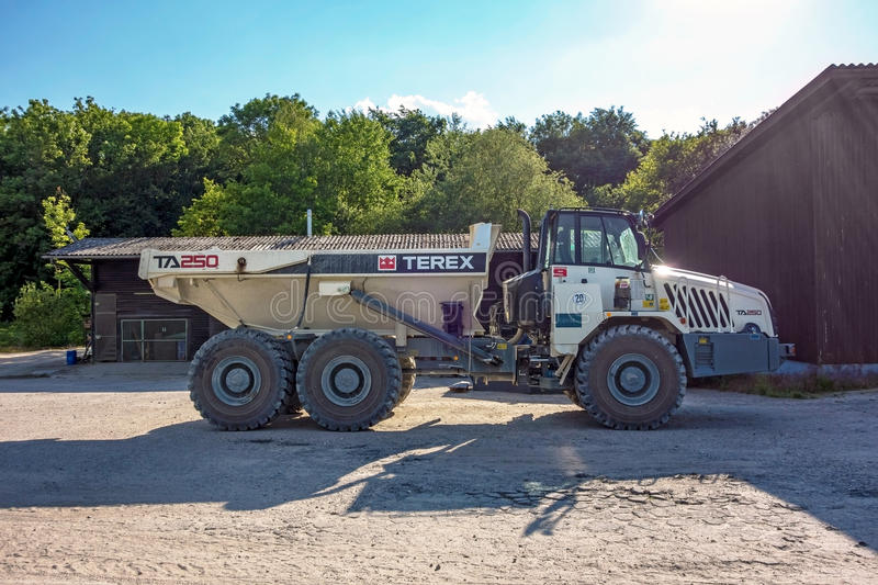 Huge Truck. Hagenbach, Germany - May 31, 2014: Large Volvo Terex Truck TA 250 in open pit mining and processing plant for crushed stone, sand and gravel at royalty free stock images