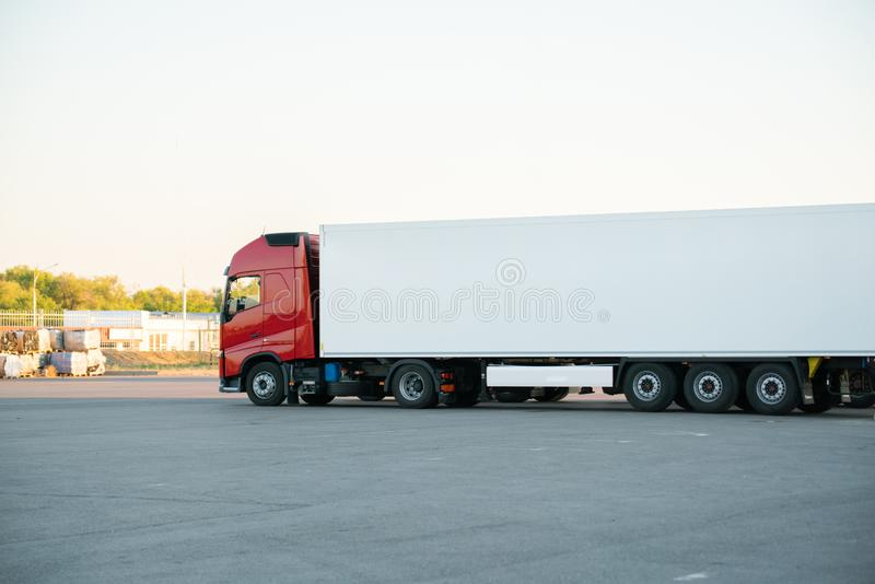 Huge truck with wagon delivering some package outdoors. Huge truck with wagon delivering some package outdoor royalty free stock images