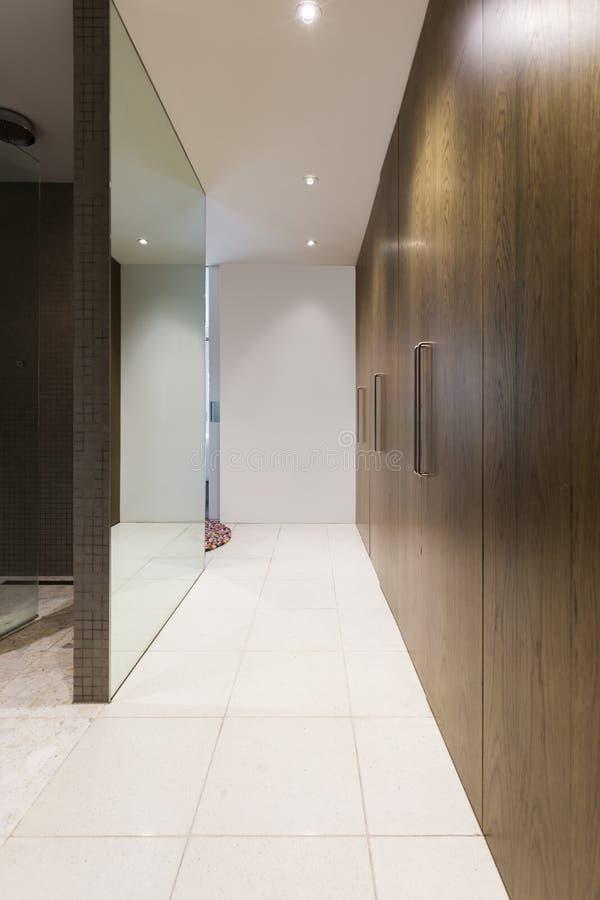Huge walk through wardrobe hallway in luxurious Australian home royalty free stock photos
