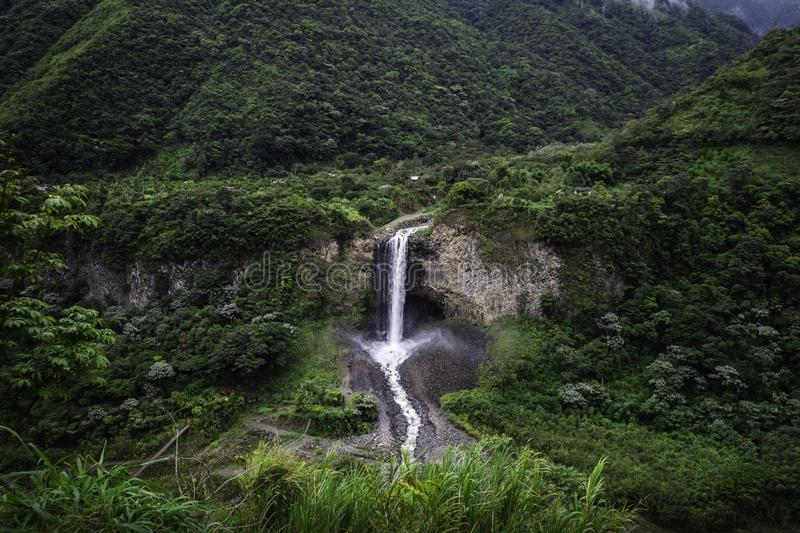 Huge waterfall in the middle of a humid forest. Holy water baths royalty free stock photos