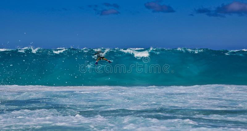 Huge wave. Dodging a huge wave in Hawaii royalty free stock photos