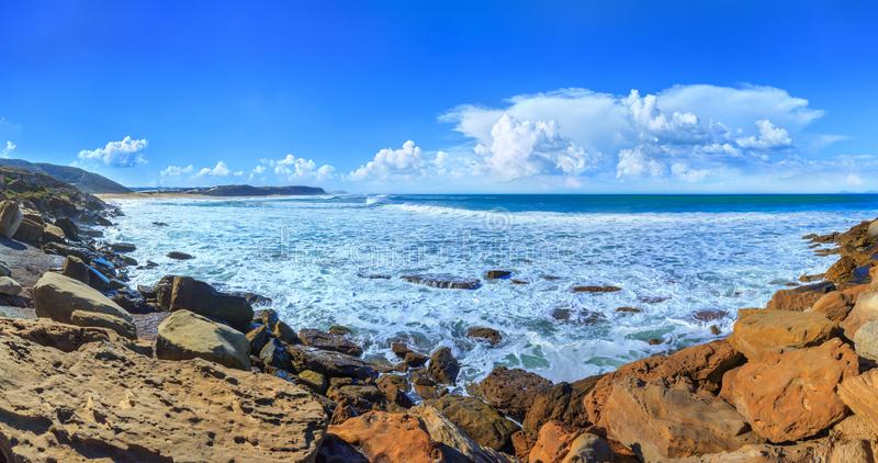 A huge waves on the ocean coast in a shine bright light  at sunny day. Wonderful romantic  panoramic seascape view of ocean stock photos