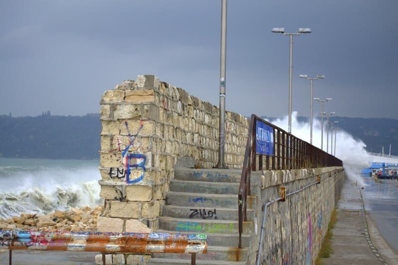 Huge waves splashes breakwater. Huge waves splashes Varna breakwater, the port is closed. Black sea coast,Bulgaria royalty free stock photo
