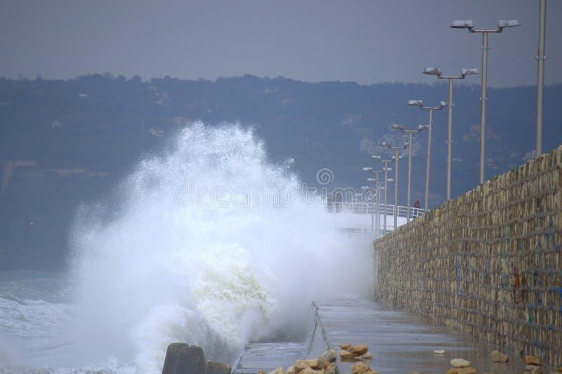 Huge waves splashes breakwater. Huge waves splashes Varna breakwater, the port is closed. Black sea coast,Bulgaria stock photos