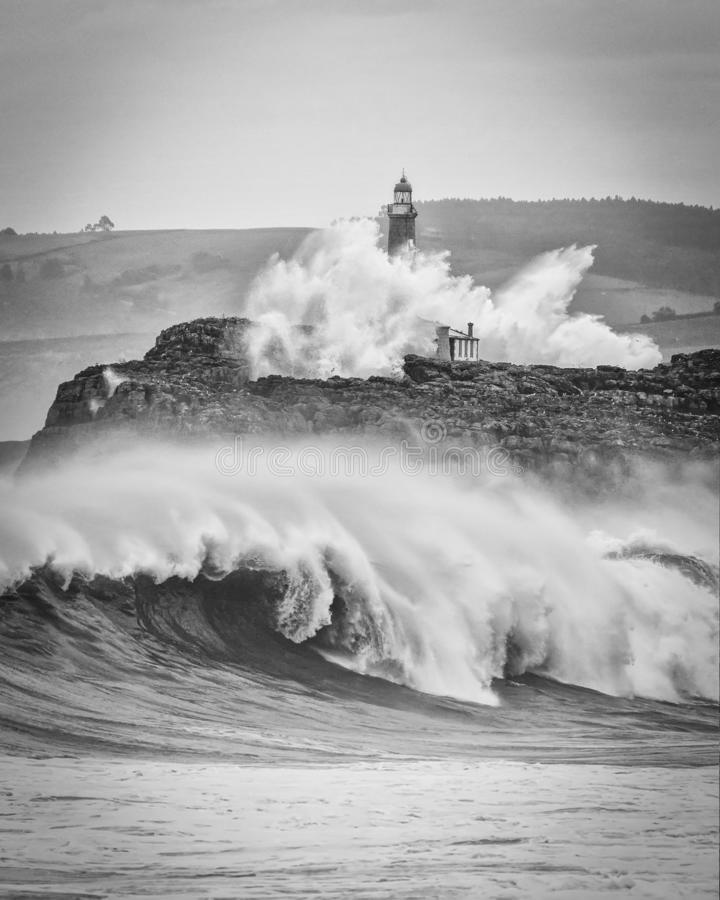 Huge waves splashing at the Mouro lighthouse royalty free stock images