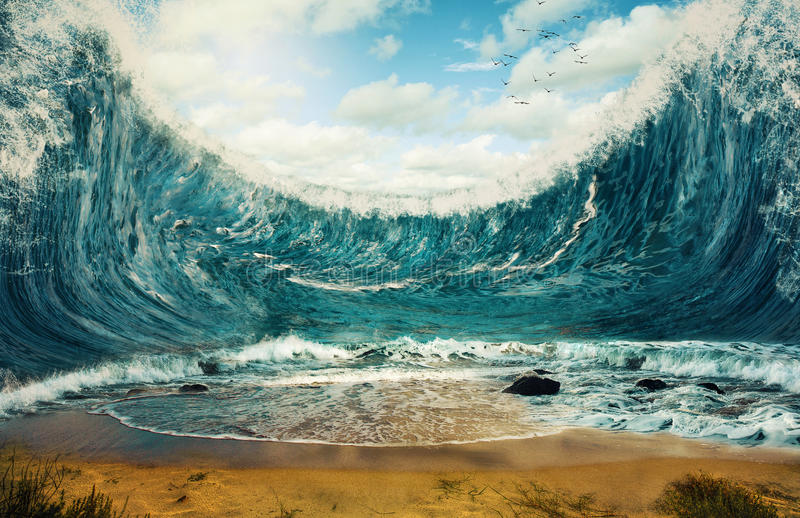 Huge waves. Surreal image of huge waves surrounding dry sand