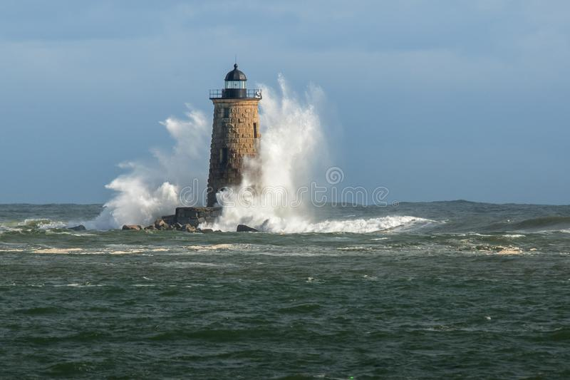 Huge Waves Surround New England Lighthouse. Huge waves surround Whaleback lighthouse, in southern Maine after a New England winter snowstorm passes by causing stock image