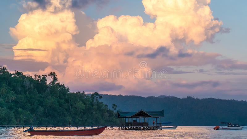 Huge White Clouds above Diving Station on Sunset, Homestay Gam Island, West Papuan, Raja Ampat, Indonesia. Huge White Clouds above Diving Station on Sunset royalty free stock image