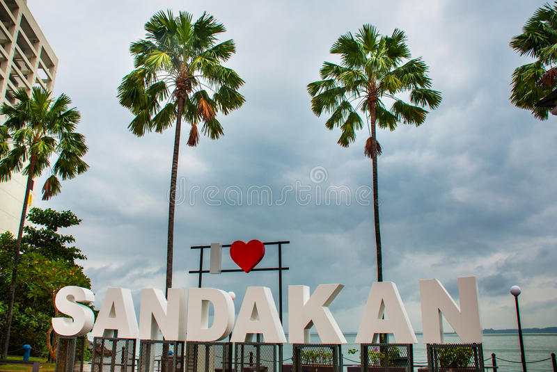 Huge white letters that says I love Sandakan and palm trees. Borneo, Sabah, Malaysia. Huge white letters that says I love Sandakan and palm trees. Sandakan city stock photos
