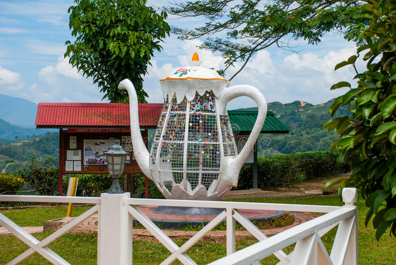 Huge white metal kettle. Colorful padlocks heart shaped on blurred background, symbol of love. Sabah, Borneo, Malaysia. Huge white metal kettle. Colorful royalty free stock photo