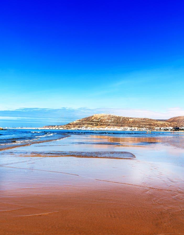 The huge wide sand beach of Agadir, Morocco stock photo