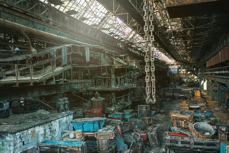 Huge workshop of the abandoned metallurgical plant of the Soviet Union times royalty free stock image