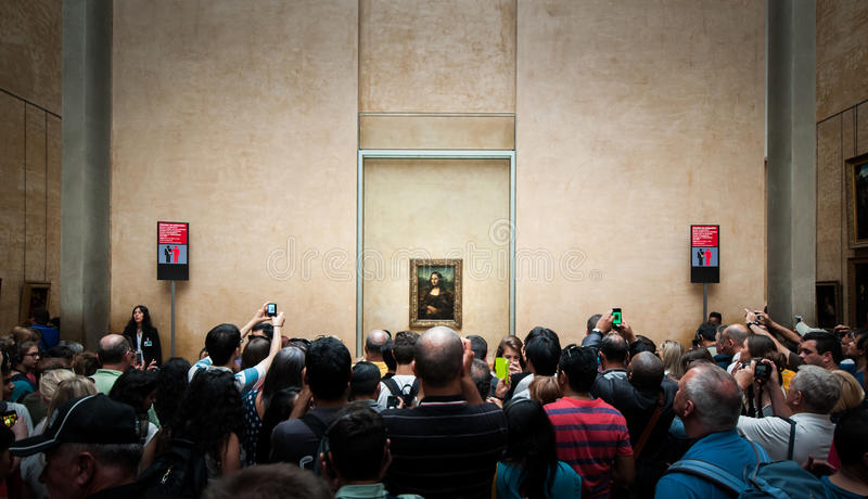 A huged of visitors take photo of Mona-Lisa in Louvre museum stock photo