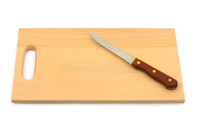 hugga av kniv för bräde fotografering för bildbyråer