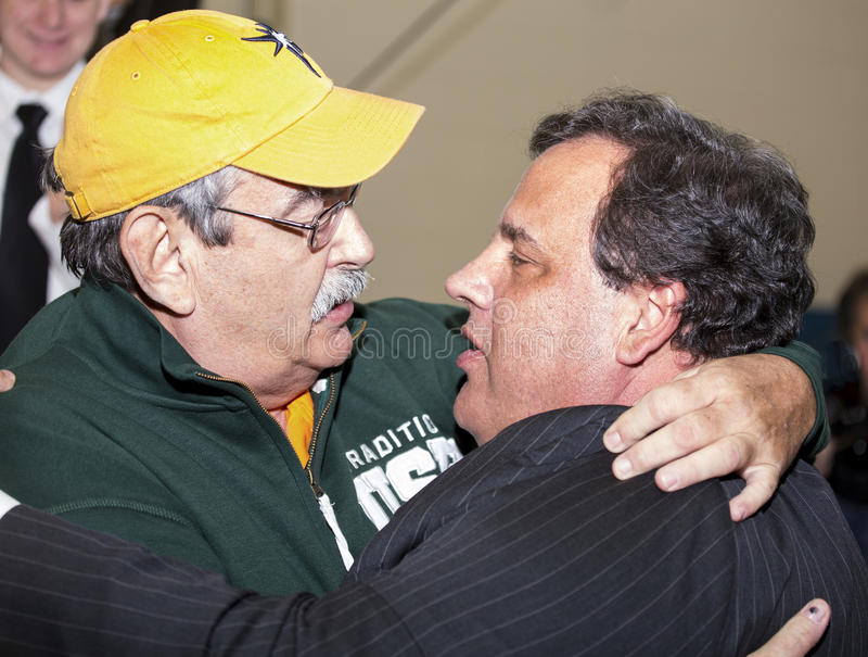 Hugging the Governor. Following his keynote speech, as he was leaving the Livingston High School Fieldhouse, New Jersey governor Chris Christie is given a stock photos