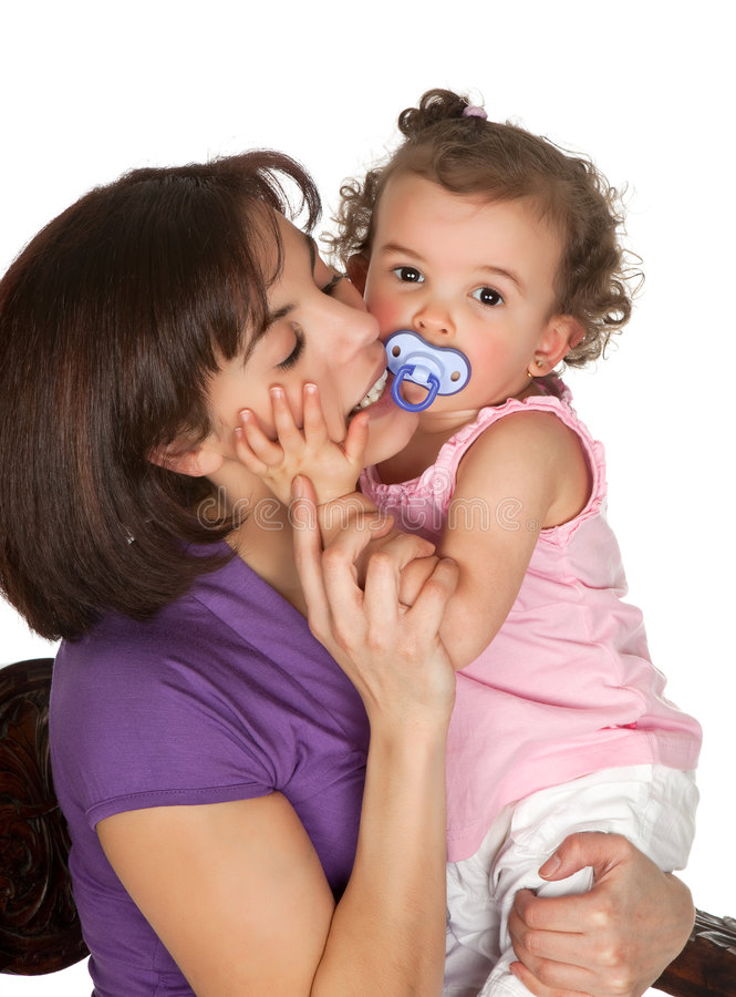 Hugging mother. Loving mother hugging her little toddler girl royalty free stock image