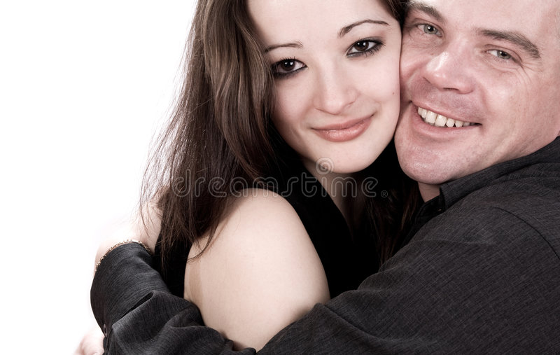 Hugging young couple. Studio shot of young loving couple caring stock image