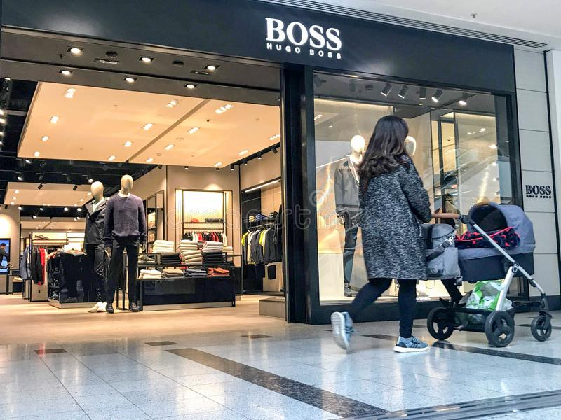 BOSS store. Hugo Boss AG, often styled as BOSS, is a German luxury fashion house headquartered in Metzingen, Germany. It was founded in 1924 by Hugo Boss and stock images