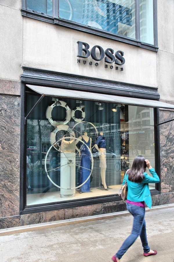 Hugo Boss. CHICAGO, USA - JUNE 26, 2013: Person walks by Hugo Boss store at Magnificent Mile in Chicago. The Magnificent Mile is one of most prestigious shopping stock photography