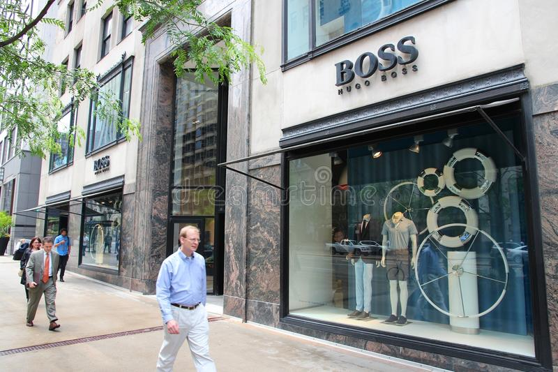 Hugo Boss store. CHICAGO - JUNE 26: People walk past Hugo Boss store at Magnificent Mile on June 26, 2013 in Chicago. The Magnificent Mile is one of most stock photo