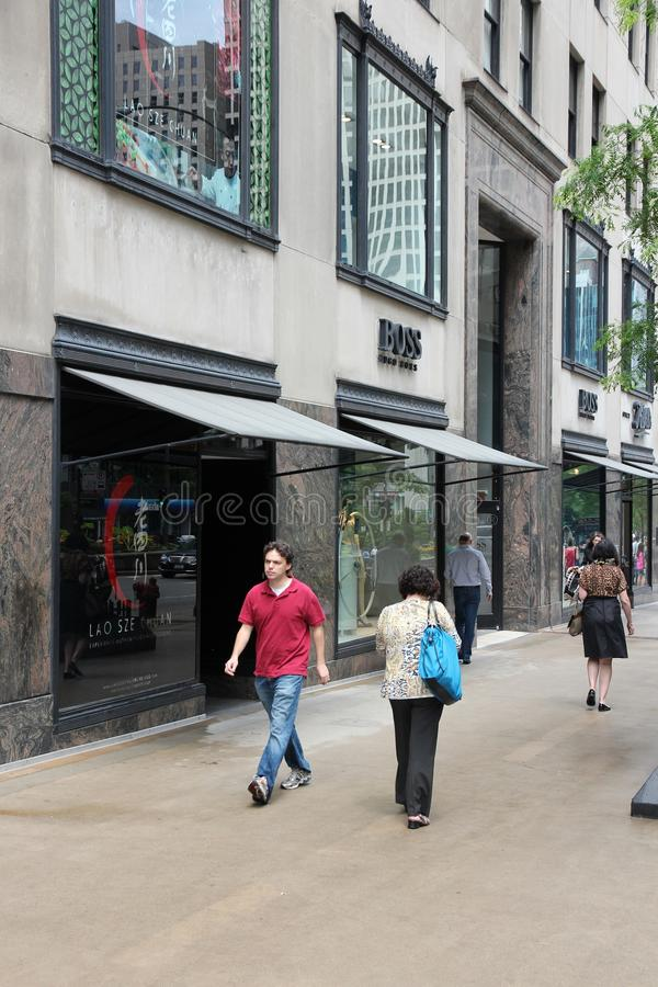 Hugo Boss store. CHICAGO, USA - JUNE 26, 2013: People walk by Hugo Boss store at Magnificent Mile in Chicago. The Magnificent Mile is one of most prestigious royalty free stock photos